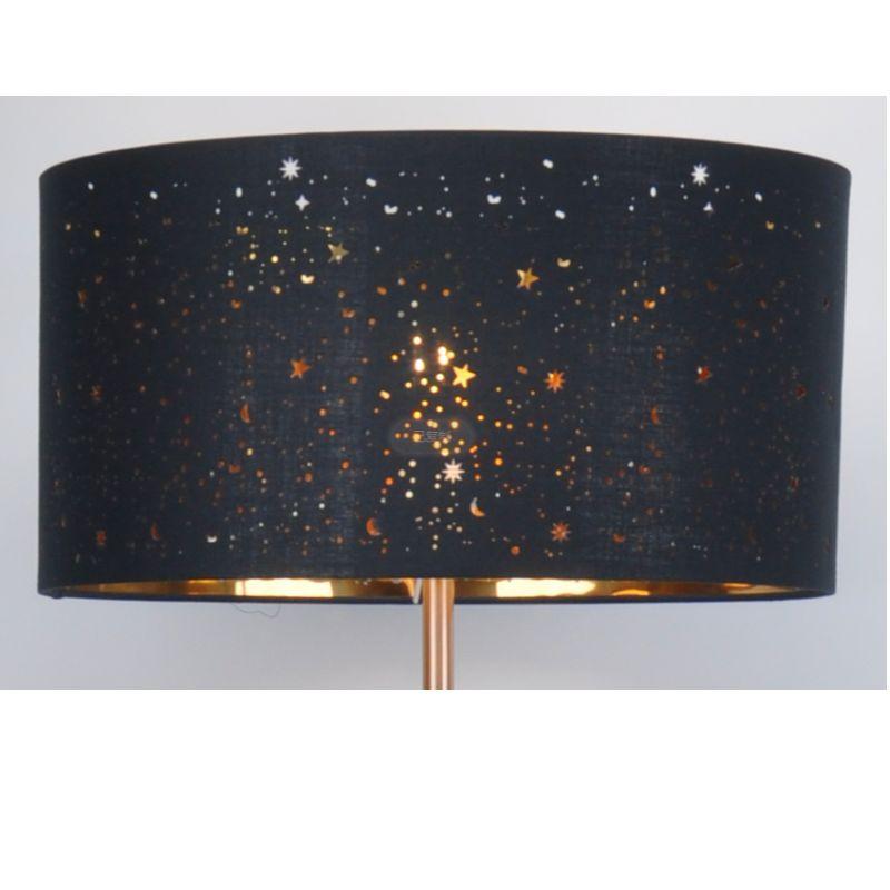 Floor lamp with laser cut black fabric shade